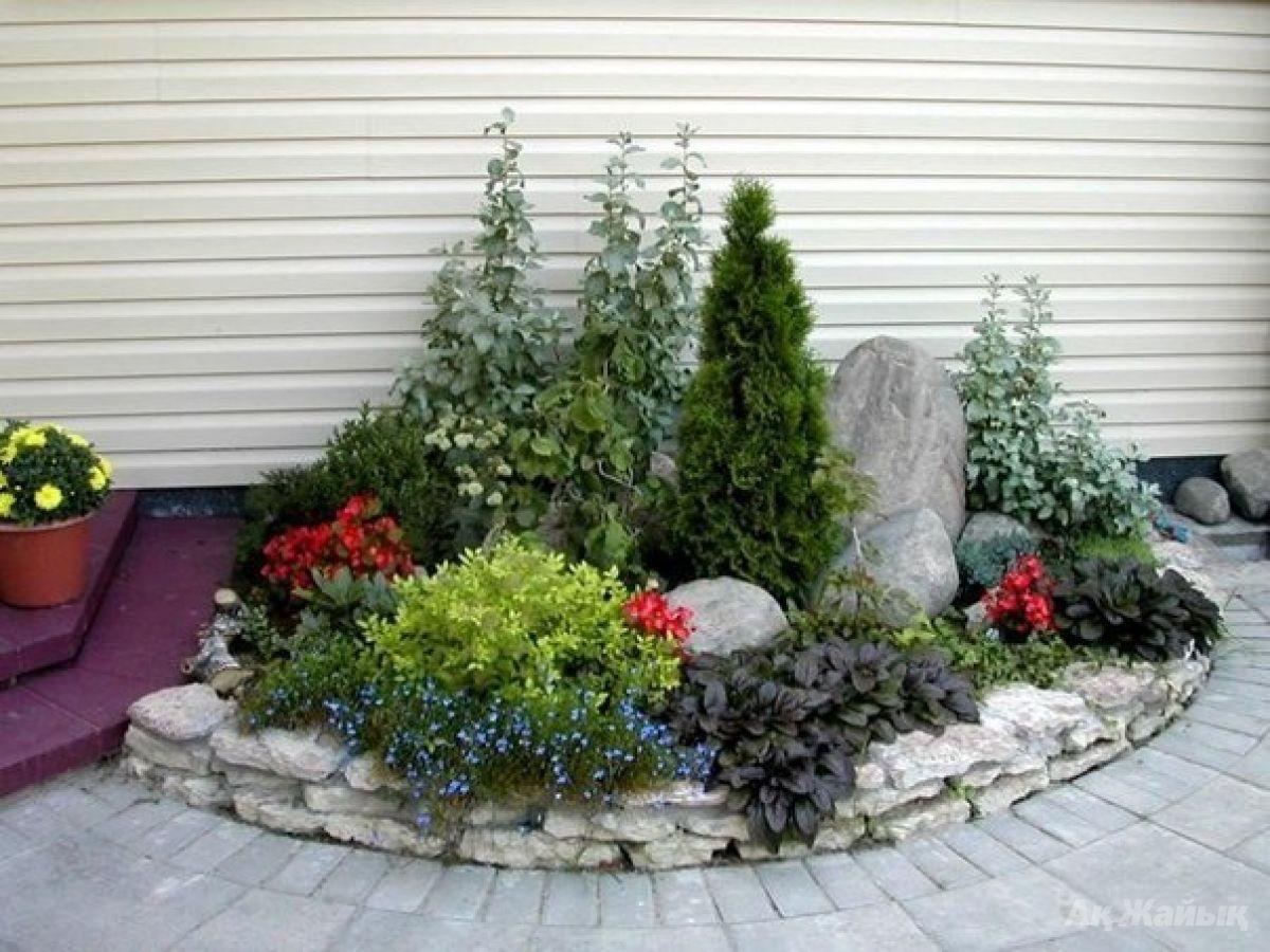 Дизайн цветника из камней